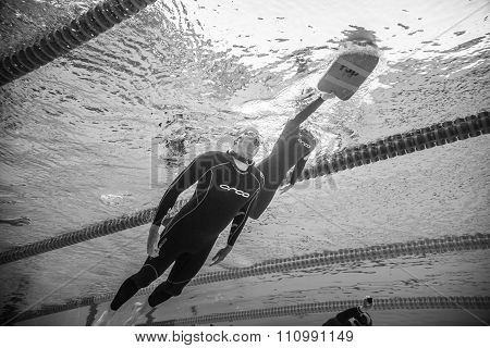 Dynamic No Fins Freediver Going Out Of The Water From Underwater