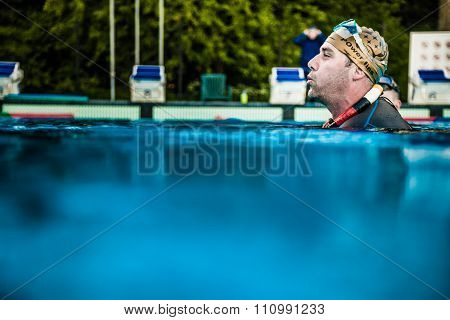 Freediver Holding His Self Out Of The Water After Dynamic Performance