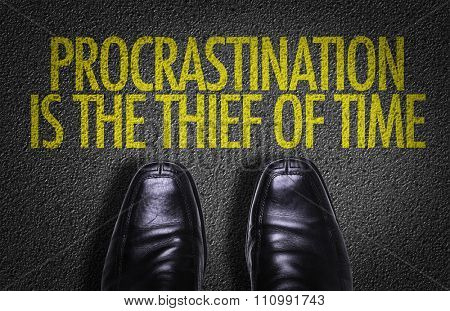 Top View of Business Shoes on the floor with the text: Procrastination is the Thief of Time