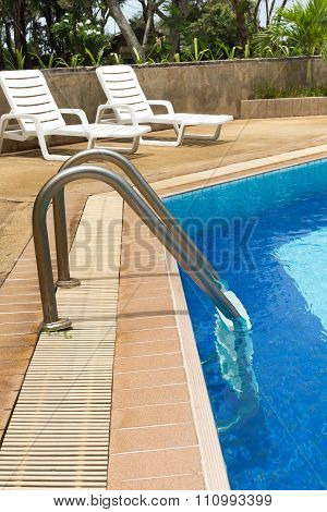 Swimming Pool Ladder And Sunloungers