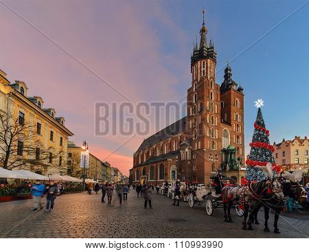 Market Square Of The Old City In Krakow Decorated By The Christmas Lights.