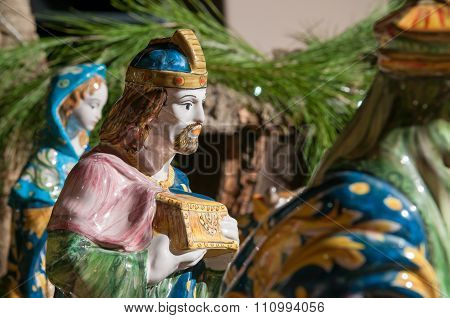 Painted pottery statue portraying one of the three wise men work by a ceramic artisan in Caltagirone poster