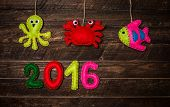New year background with Christmas handmade toys made of felt on dark rustic wooden background. Holiday card - 2016 happy new year! poster