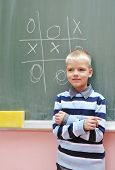 happy young boy at first grade math classes solving problems and finding solutions poster