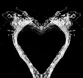 Stylish water splash. Isolated on black background poster