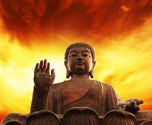 Picture of a Statue of Buddha over yellow sky poster