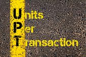 Concept image of Accounting Business Acronym UPT Units Per Transaction written over road marking yellow paint line. poster