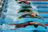 swimming: women's backstroke race start. generic action with blur poster
