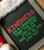 Kindness Is a Language That the Dead Can Hear And The Blind Can See written on blackboard with santa hat poster