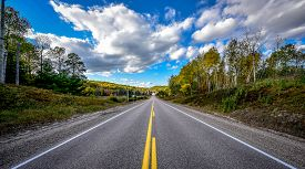Highway to anywhere - bright summer day on country roads.