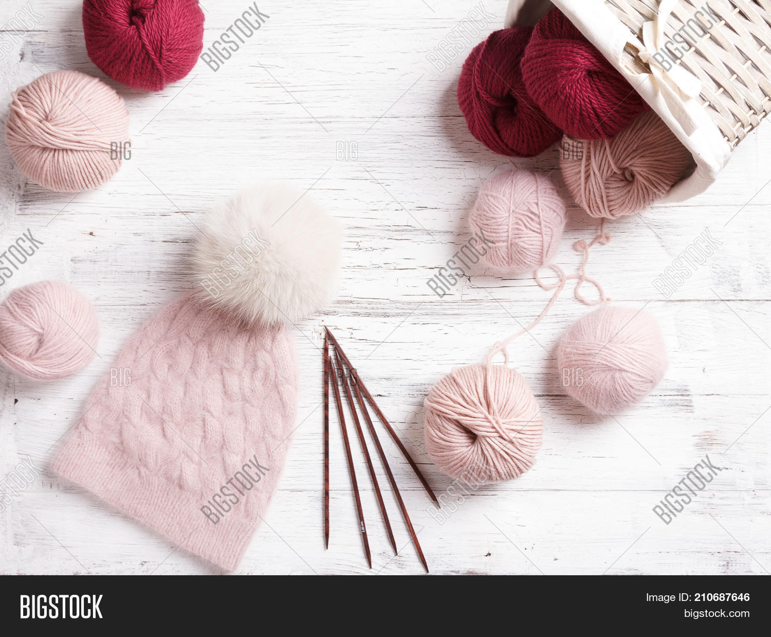 aa0a5950355 Beautiful knitted hat with fur pompom. Knitted warm hat with pink coils of  yarn and