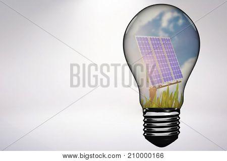 Empty light bulb against blue sky
