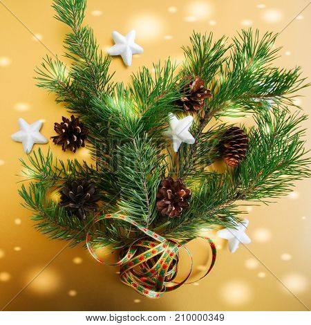 Fir Tree Branches With Cones And Stars Over Golden Background, Festive Decoration. Square Image.