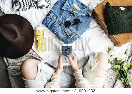 Woman sitting and prepare clothing for new journey