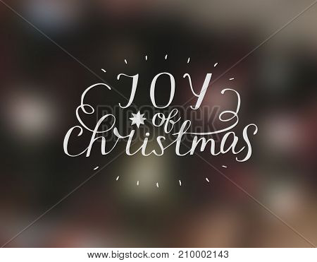 Hand lettering Joy of christmas with star. Biblical background. Christian poster. Modern calligraphy Card Holiday
