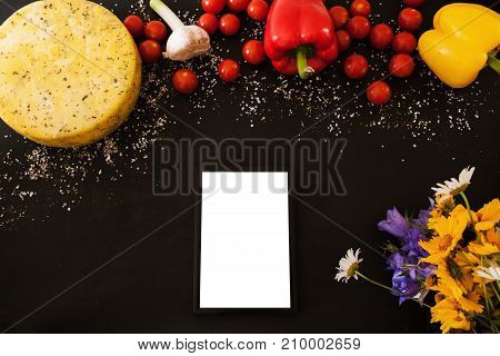 Food composition of gourmet products, top view free space. Quality sort of Caciotta with herbs and vegetables. Menu and recipe concept