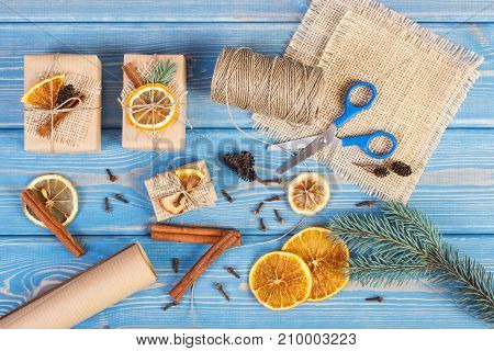 Accessories, Decoration And Wrapped Gifts For Christmas Or Other Celebration On Old Blue Boards