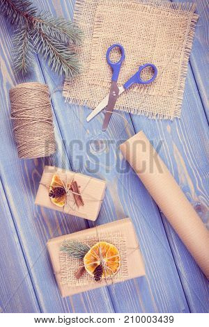 Vintage Photo, Accessories, Decoration And Wrapped Gifts For Christmas Or Other Celebration Lying On