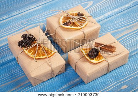 Wrapped Gifts With Decoration For Christmas Or Other Celebration On Old Blue Boards