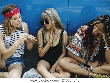 Group of Diverse Friends on Road Trip Sitting by the Car Together