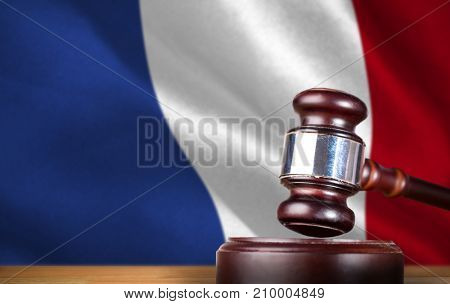 Hammer and gavel against 3d  digitally generated french national flag