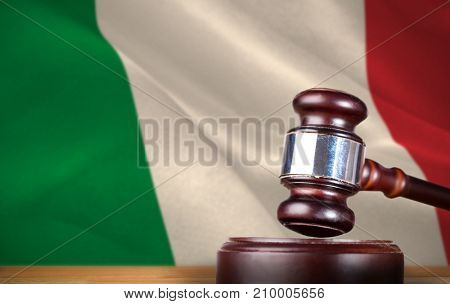 Hammer and gavel against 3d digitally generated italian national flag