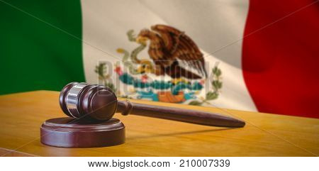Hammer and gavel against 3d against digitally generated mexican national flag