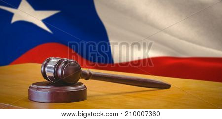 Hammer and gavel against 3d digitally generated chile national flag
