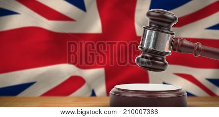 Hammer and gavel against 3d digitally generated great britain national flag