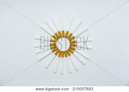 circle shaped cigarette on isolated white background composition photography