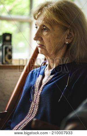 Side view of senior caucasian woman with thoughtful face expression