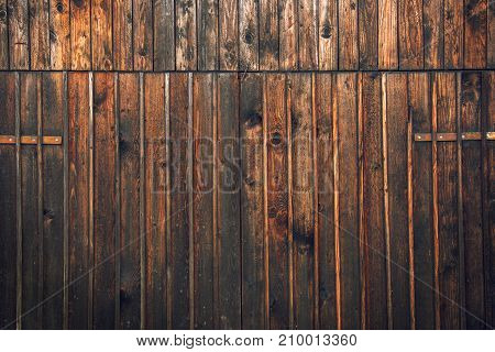 Wooden barn shed door as background or texture typical traditional Alpine farm gate located in Slovenian touristic village Ribcev laz next to the Bohinj lake