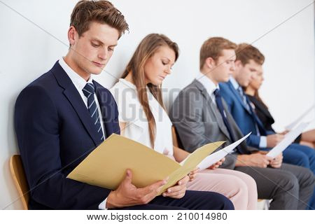 Five candidates waiting for job interviews, close up