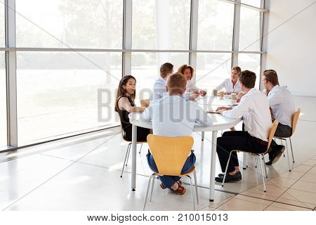 Young business professionals in team meeting