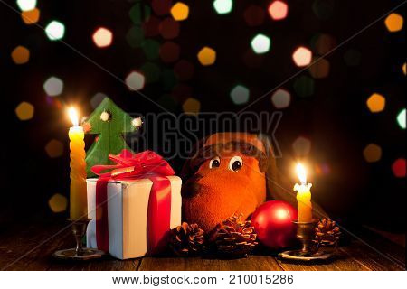 New year's night. Celebratory lights. Gifts and the symbol of the year. Christmas decorations and candles.