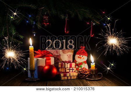 New Year 2018. Decorations and gifts. Spruce branches and Bengal lights. Symbols of the New Year.