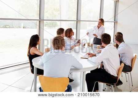 Businesswoman presenting a document at a office team meeting