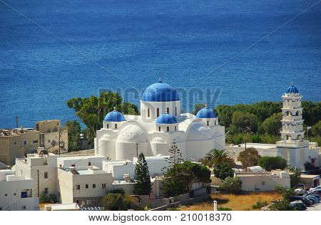 A sunny day and the church of Timiou Stavro the Holy Cross in Perissa on Santorini