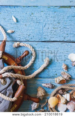 Striped Bag, Wheel And Maritime Decorations On The Wooden Background
