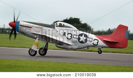North American P51 D Mustang fighter used by the Tuskegee airmen, the first all black American squadron at the inaugural RAF Scampton air show in Lincolnshire, UK, 10 September, 2017.