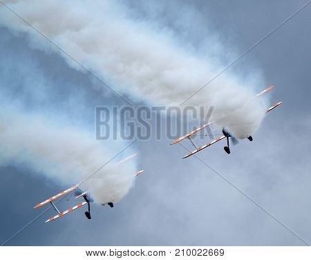 Wing Walking display with girls and Boeing PT17 Stearman 450 vintage aircraft at the inaugural air show at RAF Scampton in Lincolnshire, UK, on 10 September, 2017.