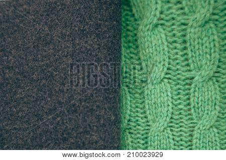 Handmade green knitting wool texture background. Clothing.