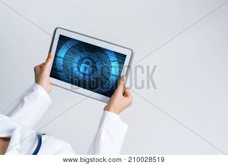 Tablet pc device with security padlock on screen in hands of doctor