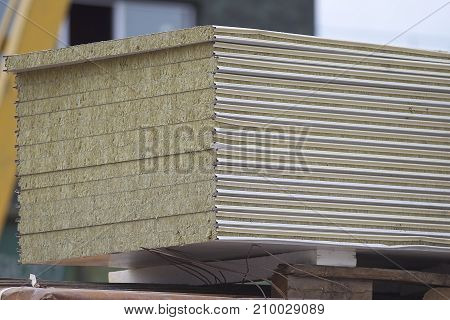 Wall panels with a heater in a pack in a warehouse Russia