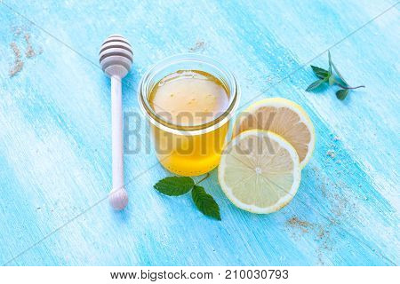 Natural cold and  flu remedy: honey and fresh  lemon.