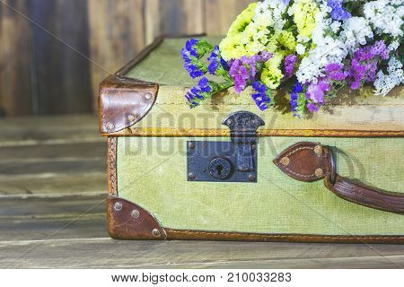 Old travel bag with delicate in flowers