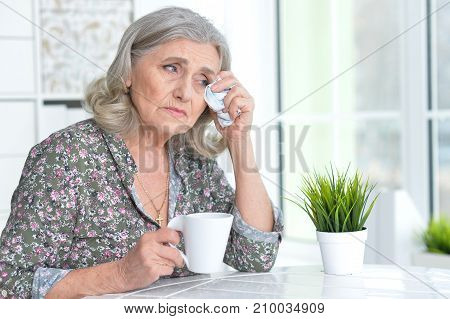 Portrait of a cute crying senior woman