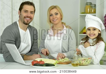 Smiling family having breakfast at kitchen table