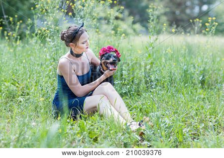 Portrait of a girl and a dog in the field