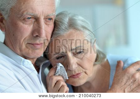 Portrait of sad senior couple looking away